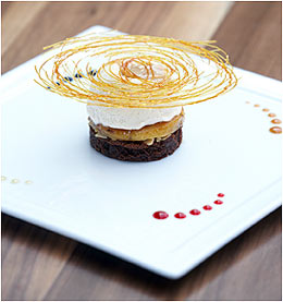 Dadis famous brownie served with caramelized baby bananas, champagne mousse and 4 different sauces