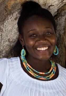 haitian woman making jewelry